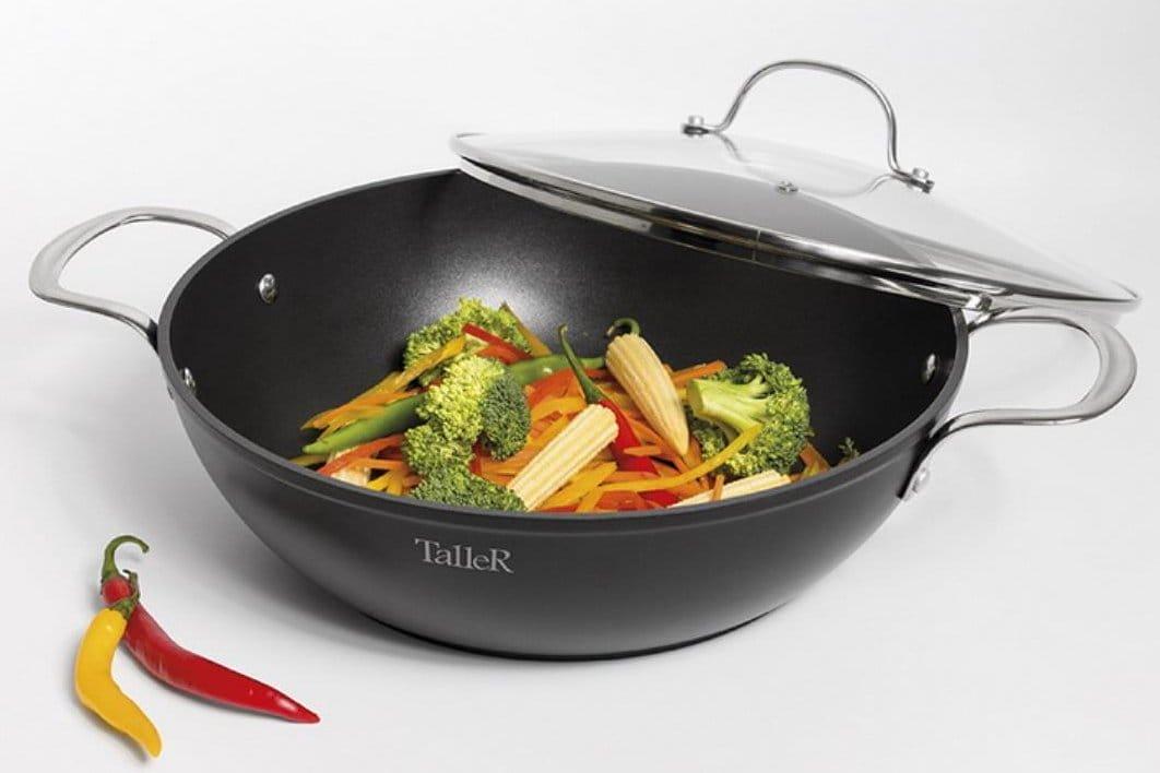 """Для чого потрібна сковорода-вок: що це таке, що означає """"Вок"""", що готують в wok, для чого застосовується китайська сковорідка, як вибрати, що можна готувати"""