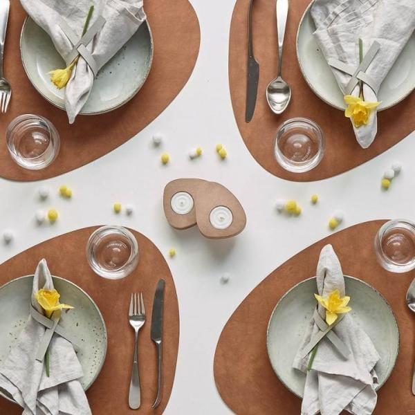 Красиві сервірувальні килимки під тарілки: як називаються підкладки на стіл, шкіряні, круглі, пластикові, бамбукові підставки, як вибрати